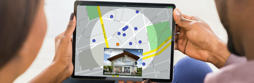 Couple using tablet to find property